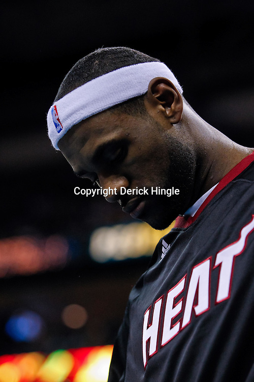 October 13, 2010; New Orleans, LA, USA; Miami Heat small forward LeBron James (6) watches from the bench during a preseason game against the New Orleans Hornets at the New Orleans Arena. The Hornets defeated the Heat 90-76. Mandatory Credit: Derick E. Hingle
