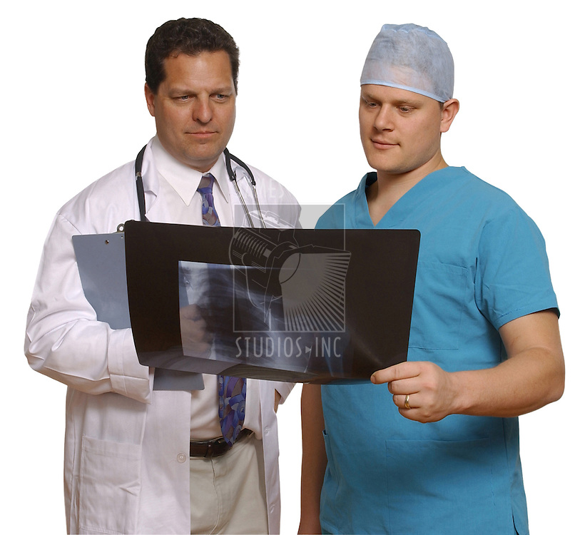 doctor and surgeon holding x-ray on white background