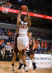 Virginia forward Mike Scott (32) grabs a rebound in action against Brown.  The Virginia Cavaliers defeated the Brown University Bears 74-50 in NCAA Basketball at the John Paul Jones Arena on the Grounds of the University of Virginia in Charlottesville, VA on January 6, 2009.