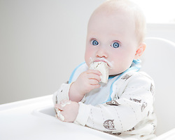 Baby with Messy Face Eating