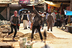 April 27, 2018 - Srinagar, Jammu and Kashmir, India - A protester throw stones towards Indian police in old city Srinagar the summer capital of Indian administered Kashmir on April 27, 2018. Minor clashes erupted in old city after the prayers ended in Jamia Masjid (Grand mosque) ,the protesting youth shouted pro freedom slogans and demanded justice for the 8-year old girl who was raped and murdered in Jammu's Kathua district in January 2018. (Credit Image: © Faisal Khan/Pacific Press via ZUMA Wire)