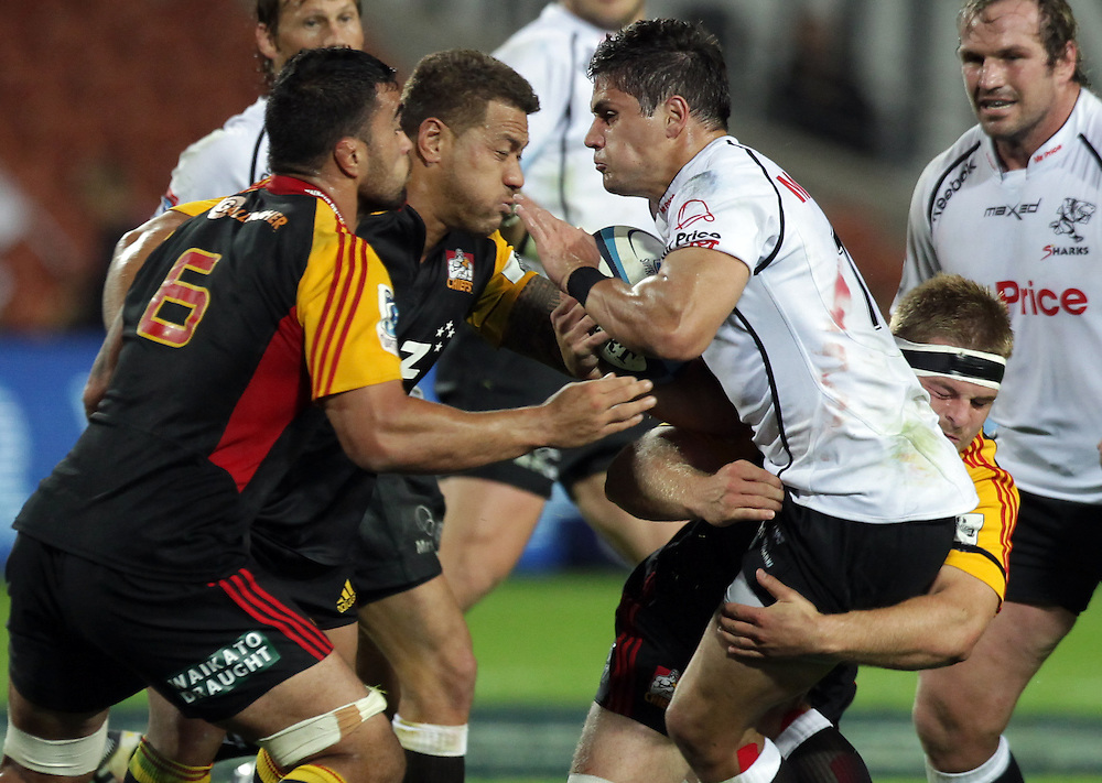 Sharks' Piet Lindeque is tackled by Chiefs' Liam Messam and Mahonri Schwalger in a Super Rugby match, Waikato Stadium, Hamilton, New Zealand, Saturday, April 27, 2013.  Credit:SNPA / David Rowland