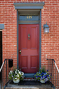 OOld brick row house doors in the better sections of older eastern American towns can be quite beautiful when decorated to welcome from street view. The residents take good care of them, make a display, and value their charm. The doors themselves are often original to the buildings. They make a very interesting art gallery of their own while casually walking the old streets on a little door tour, and there is a lot of variety according to an owner&rsquo;s taste. The doors exist in a modern day while being a direct line through history to now, and are still in use most every day.<br />