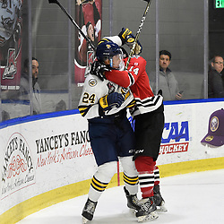 BUFFALO, NY - SEP 20,  2017: Ontario Junior Hockey League Governors Showcase game between the Mississauga Chargers and Whitby Fury, Austin Ulett #24 of the Whitby Fury becomes involved in an altercation with Allister O'Hagan #14 of the Mississauga Chargers during the second period.<br /> (Photo by Andy Corneau / OJHL Images)