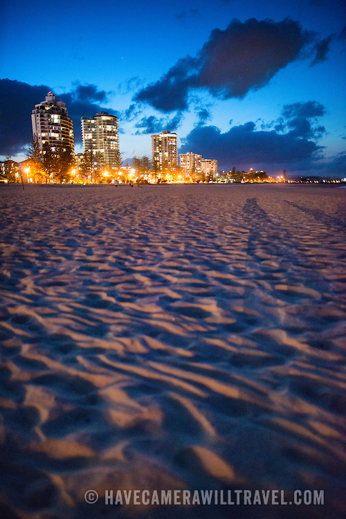 "Coolangatta's beach and skyline at dusk. Sometimes paired as ""Twin Towns,"" Coolangatta and Tweed Heads, on the southern end of the Gold Coast, straddle the Queensland-New South Wales border."