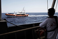 Italy: MSF Dignity1: An Italian coastal guard boat approaches the Dignity1 to transfer migrants rescued at sea on August 23, 2015. Alessio Romenzi