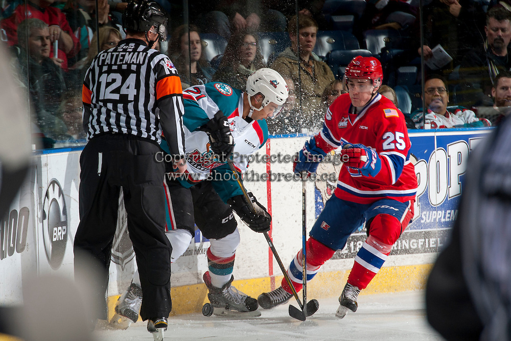 KELOWNA, CANADA - JANUARY 4: Devante Stephens #21 of the Kelowna Rockets is checked by Ondrej Najman #25 of the Spokane Chiefs on January 4, 2017 at Prospera Place in Kelowna, British Columbia, Canada.  (Photo by Marissa Baecker/Shoot the Breeze)  *** Local Caption ***