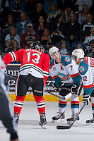 KELOWNA, CANADA - APRIL 19: Damon Severson #7 of the Kelowna Rockets lines up against Keegan Iverson #13 of the Portland Winterhawks on April 18, 2014 during Game 2 of the third round of WHL Playoffs at Prospera Place in Kelowna, British Columbia, Canada.   (Photo by Marissa Baecker/Shoot the Breeze)  *** Local Caption *** Keegan Iverson; Damon Severson;