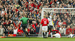 MANCHESTER, ENGLAND - Saturday, April 5, 2003: Inept Referee Mike Rielly points to the spot and awards a penalty to Manchester United against Liverpool much to the delight of the fans behind the goal during the Premiership match at Old Trafford. (Pic by David Rawcliffe/Propaganda)