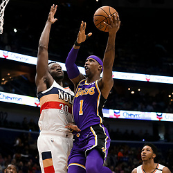 Mar 31, 2019; New Orleans, LA, USA; Los Angeles Lakers guard Kentavious Caldwell-Pope (1) shoots over New Orleans Pelicans center Julius Randle (30) during the first quarter at the Smoothie King Center. Mandatory Credit: Derick E. Hingle-USA TODAY Sports