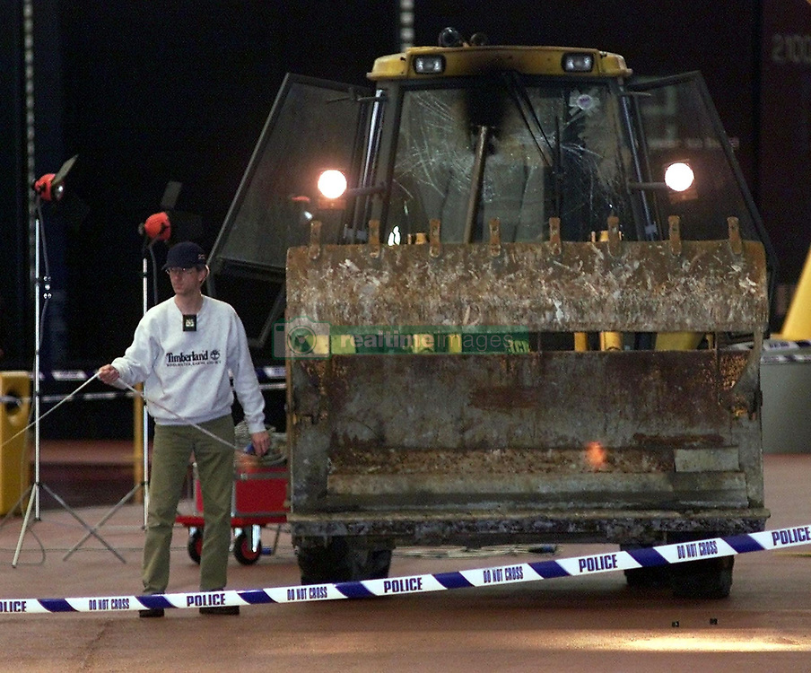 """An excavator at the scene after a raid on  350 million of diamonds on show at the Millennium Dome in SE London.  Six people were arrested, including four in the Money zone vault, and two by the River Thames, where the robbers had a powerboat.  *... waiting to speed them from the scene. In scenes reminiscent of the James Bond film The World is Not Enough, the raiders used a bulldozer to break into the Dome. Had it been successful, it would have been the world's largest ever robbery.    * 08/11/2001: Police foiled the """"robbery"""" of the jewels when they caught raiders red handed as they smashed their way in using a mechanical digger, an Old Bailey court heard, at the opening of the trial of six men accused of plotting to rob the De Beers Millennium Diamond Exhibition with others unknown."""