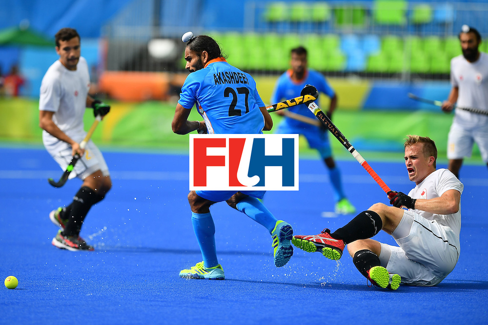 India's Akashdeep Singh (C) plays the ball during the mens's field hockey India vs Canada match of the Rio 2016 Olympics Games at the Olympic Hockey Centre in Rio de Janeiro on August, 12 2016. / AFP / Carl DE SOUZA        (Photo credit should read CARL DE SOUZA/AFP/Getty Images)