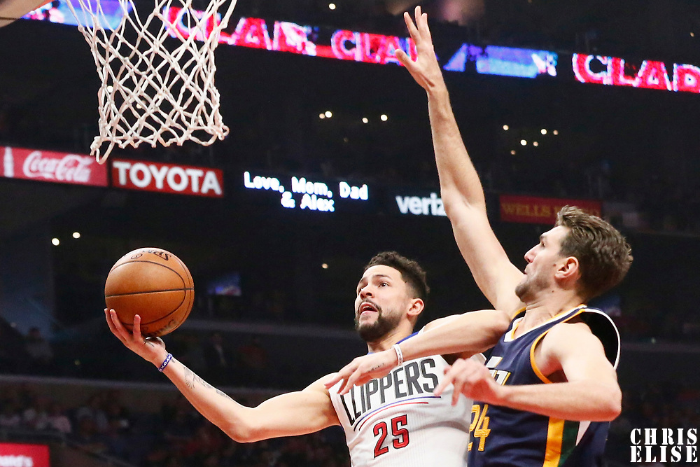 25 March 2016: LA Clippers guard Austin Rivers (25) goes for the layup against Utah Jazz center Jeff Withey (24) during the Los Angeles Clippers 108-95 victory over the Utah Jazz, at the Staples Center, Los Angeles, California, USA.