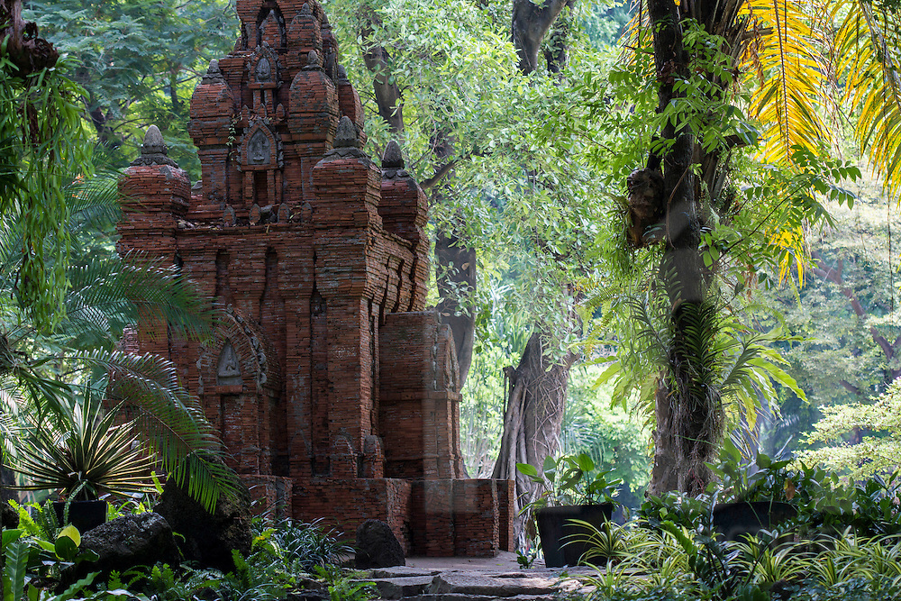 Vestiges of an old Cham temple raising among a primeval forest. Tao Dan Park, Ho Chi Minh city, Vietnam, Southeast Asia