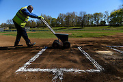 """Now let the kids play. It's all about the kids,"" says Greg Walker, 35, a Hartford Public Works employee who lines the batter's box at Mayor Mike Peter's Little League at Highland Park in Hartford on Wednesday morning in April 2016. Walker maintains the city's baseball diamonds everyday during the spring and summer. This Highland Park field was the last of four diamonds he lined on Wednesday morning."