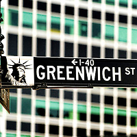 Close up of Greenwich Street sign in Lower Manhattan, New York City, against the background of office buildings.