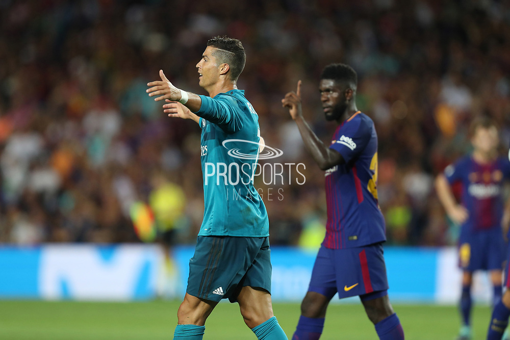 Cristiano Ronaldo of Real Madrid walks from the ground after he was given a red card during the Spanish Super Cup football match between FC Barcelona and Real Madrid on August 13, 2017 at Camp Nou stadium in Barcelona, Spain. - Photo Manuel Blondeau / AOP Press / ProSportsImages / DPPI