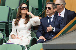 © Licensed to London News Pictures. 12/07/2019. London, UK. Rebecca Bana and Eric Bana watch centre court tennis in the royal box on Day 11 of the Wimbledon Tennis Championships 2019 held at the All England Lawn Tennis and Croquet Club. Photo credit: Ray Tang/LNP