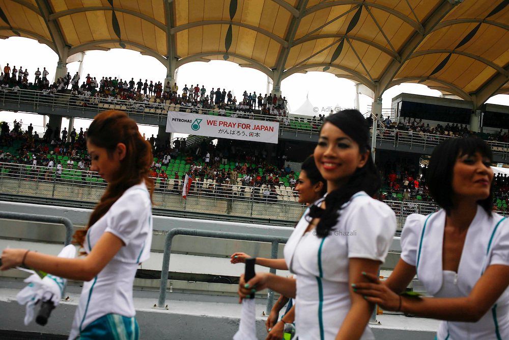 "A banner that written ""We Pray for Japan"" was been hold up at  the Malaysian Formula One Grand Prix in Sepang, Malaysia, Sunday, April 10, 2011."