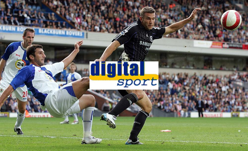 Photo: Paul Thomas.<br /> Blackburn Rovers v Chelsea. The Barclays Premiership. 27/08/2006.<br /> <br /> Zurab Khizanishvili (L) of Blackburn just clears the ball away from Andriy Shevchenko.