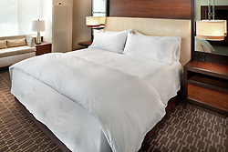 Marriott Hotel bedroom with white sheet set and queen bed