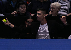 2018?11?12?.    ?????1???——?·??????ATP?????.      11?12????????·??????????????????????????.      ???????????2018ATP????????????????????????????2?0???????????.       ????????.(SP)BRITAIN-LONDON-TENNIS-ATP WORLD TOUR FINALS-DAY 2-CRISTIANO RONALDO .(181112) -- LONDON, Nov. 12, 2018  Cristiano Ronaldo (C) grasps a tennis ball whilst sitting courtside during the single's match between John Isner of the United States and Novak Djokovic of Serbia during Day Two of the 2018 ATP World Tour Finals at the O2 Arena in London, Britain on Nov. 12, 2018. (Credit Image: © Xinhua via ZUMA Wire)