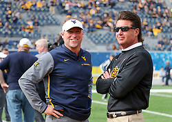 Oct 28, 2017; Morgantown, WV, USA; West Virginia Mountaineers head coach Dana Holgorsen and Oklahoma State Cowboys head coach Mike Gundy talk before their game at Milan Puskar Stadium. Mandatory Credit: Ben Queen-USA TODAY Sports
