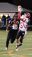 Sophomore Airius Moore (45) watches sophomore Tristan Davis (25) catch a Javon Harrison pass as the Wayne Warriors play the Beavercreek High School Beavers at the Frank Zink Field in Beavercreek, Friday, October 7, 2011.