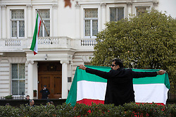 © Licensed to London News Pictures. 02/12/2011. An Iranian man shouts anti Iranian Government slogans in front of the Iranian Embassy in London Today (02/12/2011). Diplomats working at the Iranian embassy in London have been given this afternoon as a deadline to leave the UK, after the British embassy in Tehran was stormed. Photo credit: Ben Cawthra/LNP