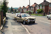 Ford Cortina after Car Crash,  Micklefield Rd, High Wycombe, UK, 1980s.