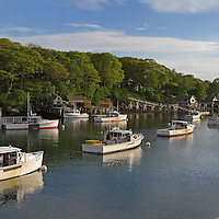 New Harbor, Maine nested into the granite seacoast away from the Atlantic Ocean in Maine on a beautiful New England late afternoon. New Harbor is a small coastal village in the town of Bristol in Lincoln County of Maine. The picturesque New England village is a working harbor residing on the mid-coast of Maine and has a rich history of fishing, lobster boating and boat building. New Harbor is located on the beautiful Pemaquid Peninsula that also calls home to one of the moist iconic lighthouses in New England, Pemaquid Head Light. Fort William Henry is nearby too. Life is simple, peaceful and relaxed in New Harbor.<br />