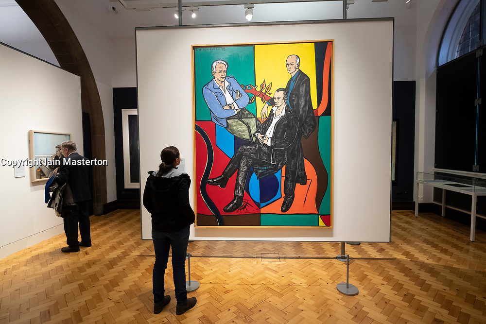 Woman looking at painting The Citizens by Adrian Wiszniewski at Scottish National Portrait Gallery in edinburgh, Scotland, UK