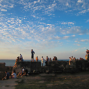 Locals and tourists alike watch the sunset from the ruins of the Forte de Ponta Fortress, Morro de São Paulo, Bahia, Brazil. Photo by Jen Klewitz