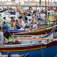 VENICE, ITALY - JULY 19:  Boats and party goers gather in St Mark's Basin on the day of the Redentore Celebration on July 19, 2014 in Venice, Italy. Redentore , which is in remembrance of the end of the 1577 plague, is one of Venice's most loved celebrations. Highlights of the celebration include the pontoon bridge extending across the Giudecca Canal, gatherings on boats in the St. Mark's Basin and a spectacular fireworks display.  (Photo by Marco Secchi/Getty Images)