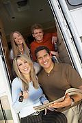 Happy Family in Doorway of New RV