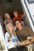 Happy Family in Doorway of New RV