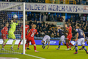 GOAL 1-0 Millwall midfielder Shaun Williams (6) scores during the EFL Sky Bet Championship match between Millwall and Nottingham Forest at The Den, London, England on 6 December 2019.