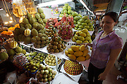 Ben Tanh Market. Fresh tropical fruit. Durians (l.), rambutan, dragonfruit, pomelo, mango etc.