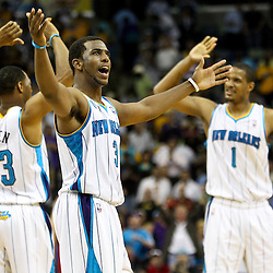 April 6, 2011; New Orleans, LA, USA; New Orleans Hornets point guard Chris Paul (3) celebrates with teammates shooting guard Willie Green (33) and small forward Trevor Ariza (1) during the fourth quarter against the Houston Rockets at the New Orleans Arena. The Hornets defeated the Rockets 101-93 and clinched a playoff spot with the victory.   Mandatory Credit: Derick E. Hingle-US PRESSWIRE