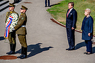 VILNIUS - King Willem-Alexander during the wreath laying at the Antakalnis cemetery in Vilnius. On the cemetery are the victims who fell in the struggle for independence in January 1991. The king brings a two-day state visit to the Baltic Republic.<br /> Copyright robin Utrecht