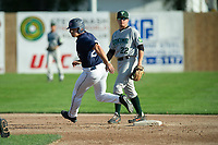 KELOWNA, BC - JULY 24: Austen Butler #28 of the Kelowna Falcons rounds second base past Tanner Parker #22 of the Yakima Valley Pippins at Elks Stadium on July 24, 2019 in Kelowna, Canada. (Photo by Marissa Baecker/Shoot the Breeze)