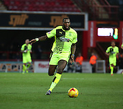 Hudderfield Town striker Ishmael Miller trying to start an attack during the Sky Bet Championship match between Brentford and Huddersfield Town at Griffin Park, London, England on 19 December 2015. Photo by Matthew Redman.