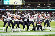 Houston Texans celebrate Houston Texans Defensive Back Jahleel Addae (37) interception during the International Series match between Jacksonville Jaguars and Houston Texans at Wembley Stadium, London, England on 3 November 2019.