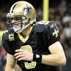 December 26, 2011; New Orleans, LA, USA; New Orleans Saints quarterback Drew Brees (9) celebrates following a touchdown against the Atlanta Falcons during a game at the Mercedes-Benz Superdome. The Saints defeated the Falcons 45-16.  Mandatory Credit: Derick E. Hingle-US PRESSWIRE