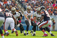 06 October 2013: Quarterback (9) Drew Brees of the New Orleans Saints  receives the snap from (60) Brian de la Puente against the Chicago Bears during the second half of the Saints 26-18 victory over the Bears in an NFL Game at Soldier Field in Chicago, IL.