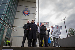 © Licensed to London News Pictures . 13/08/2014 .  Manchester , UK . Domenyk Noonan with his crew outside GMP HQ . Several campaign groups - including those campaigning over the death of Anthony Grainger as well as gangster Domenyk Noonan and those involved with the Barton Moss anti-fracking campaign - protest outside Greater Manchester Police Headquarters this afternoon ( Wednesday 13th August 2014 ) as GMP chief Sir Peter Fahy is being investigated by the IPCC over several allegations , including that a 14 year old boy was allowed to enter the home of a suspected paedophile whilst the home was under surveillance by GMP and also over the disposal of body parts in relation to the case of former Hyde GP , Harold Shipman . Photo credit : Joel Goodman/LNP