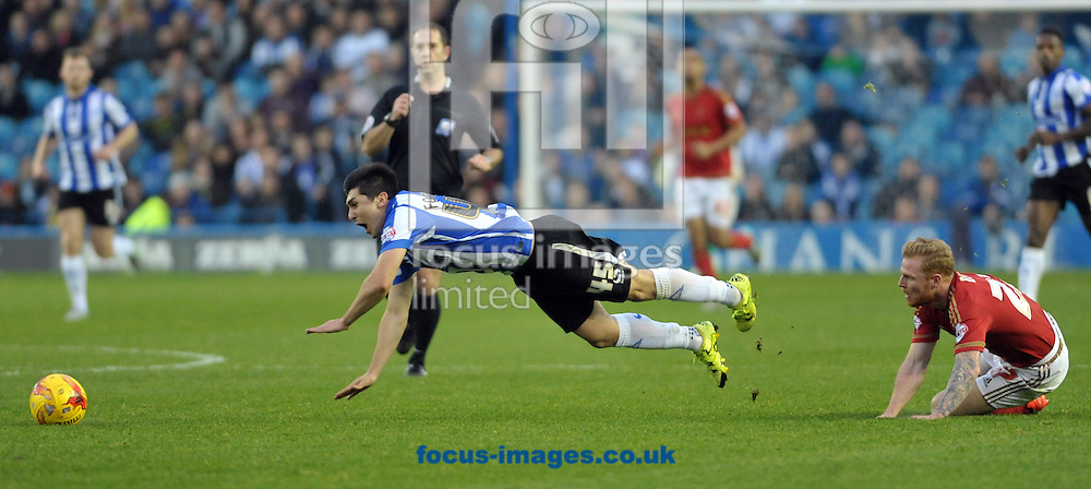 Fernando Forestieri of Sheffield Wednesday is brought down by Chris Burke of Nottingham Forest during the Sky Bet Championship match at Hillsborough, Sheffield<br /> Picture by Graham Crowther/Focus Images Ltd +44 7763 140036<br /> 31/10/2015