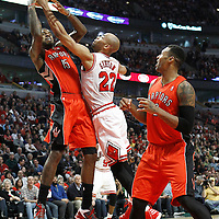 24 March 2012: Chicago Bulls forward Taj Gibson (22) vies for the rebound with Toronto Raptors power forward Amir Johnson (15) during the Chicago Bulls 102-101 victory in overtime over the Toronto Raptors at the United Center, Chicago, Illinois, USA.
