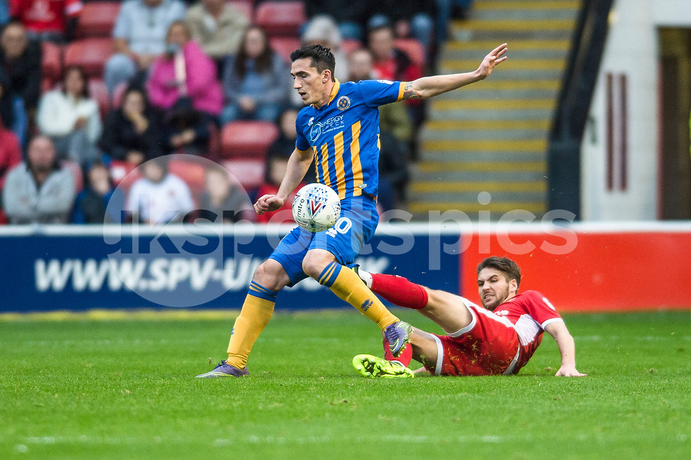 Louis Dodds wins a challenge during the EFL Sky Bet League 1 match between Walsall and Shrewsbury Town at the Banks's Stadium, Walsall, England on 7 October 2017. Photo by Darren Musgrove.