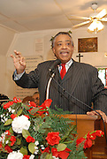 Rev. Sharpton gestures as he speaks to a crowd of about 60 gathered to hear him talk about the planned Nationalist rally on MLK day in Jena on Monday.The town of Jena Louisiana rescheduled their Martin Luther King Holiday festivities from Monday to Sunday because the Nationalist Movement planned a march in Jena on MLK day. Reverand Al Sharpton speaks Sunday Jan. 20,2008 at the Antioch Baptist Church in Jena Louisiana. Sharpton came to Jena the day before Martin Luther King holiday because the Nationalist Movement lead by Richard Barrett is to march on Jena Monday during MLK holiday. The Nationalist movement is coming to Jena in response to the Jena 6 rally last year. Sharpton was in Jena to protest the Jim Crow Justice still prevalent in the south. Sharpton discussed his feeling about MLK's legacy and how it should be celebrated and that their are still, today in the South many things to fight for, Equal Justice would be at the top of his list. Sharpton said you can not heal the community until justice is dealt with fairly, no white justice or black  justice -Equal Justice for all is what will heal the town of Jena.(Photo/© Suzi Altman).